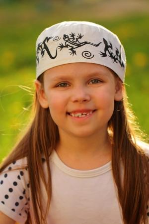 Pretty little girl outdoors