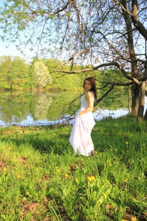 Young girl relaxing in the Spring park photo