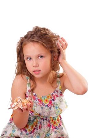 Beautiful little girl with starfish and seashell Stock Photo