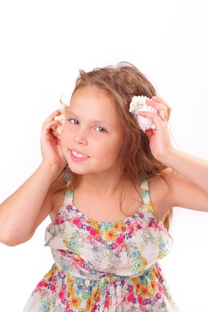 Pretty little girl with starfish and seashell Stock Photo