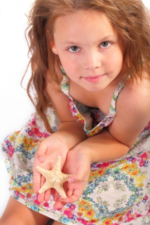 Pretty little girl with starfish Stock Photo