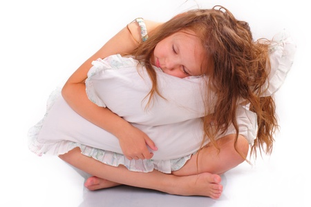 Quiet little girl with a pillow