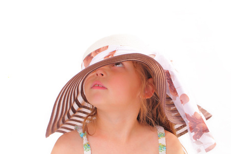 Attractive little girl in a big hat Stock Photo
