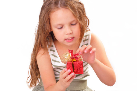 Attractive little girl with a gift for St. Valentines Day