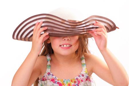 Beautiful little girl in a big hat