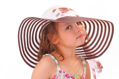 Beautiful little girl in a hat Banque d'images