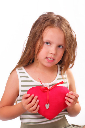 Beautiful little girl with a gift for St. Valentines Day