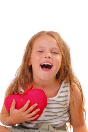 Happy little girl with a gift for St. Valentines Day Stock Photo
