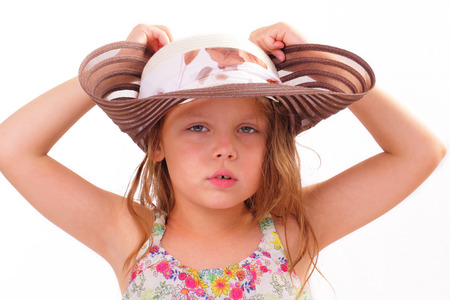 Pretty little girl in a big hat Stock Photo