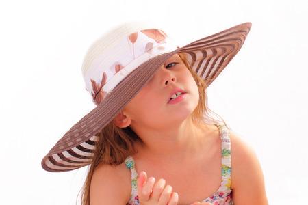 Pretty little girl in a hat