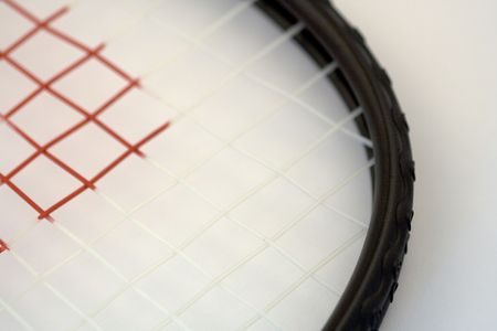 a close up of a racketball or tennis racket that is ready for a game. Stock Photo
