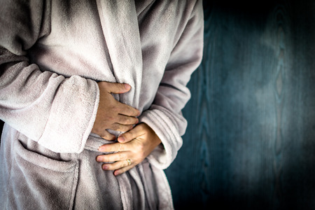 Man holding stomach with pain Stock Photo