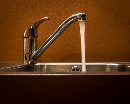 Tap Left Open On The Kitchen Sink Stock Photo, Picture And Royalty ...