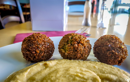 Falafel balls with hummus in a takeaway Stock Photo