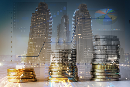 Stacked coins with a city background double exposure