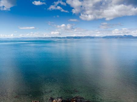Drone arial view the calm seas overlooking the Coromandel Peninsula, North Island New Zealand