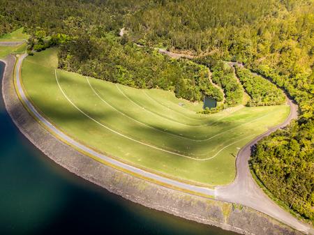 Aerial shot of a water reservoir dam wall