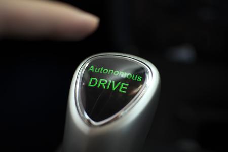 Autonomous drive button in an electric car Imagens