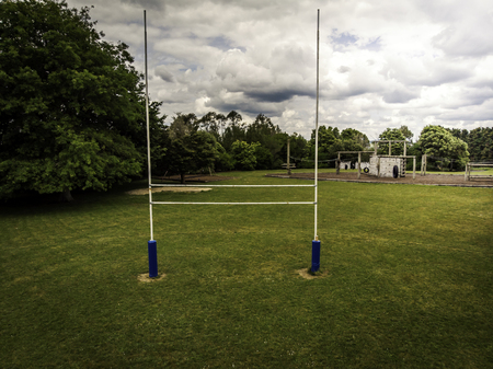 Drone view of goal posts in a rural school rugby field Imagens