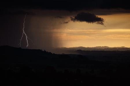 A photo of a big dark rain storm cloud approaching Foto de archivo