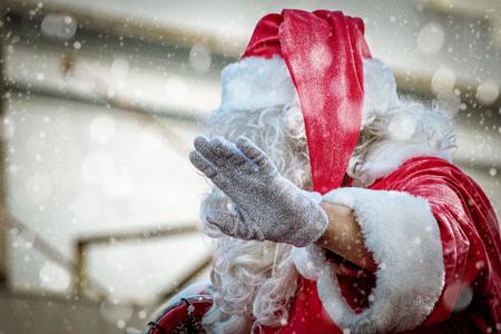 Santa waving his hand to the kids