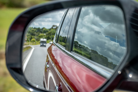 Photo of a car mirror during a drive