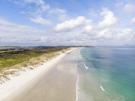 A beautiful drone photo of Puheke beach in the Karikari peninsula, Far North of New Zealand