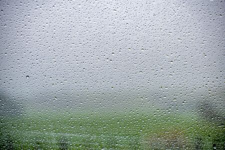 A photo of rain drops on a window
