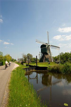 Dutch windmill near a river, spring 2008