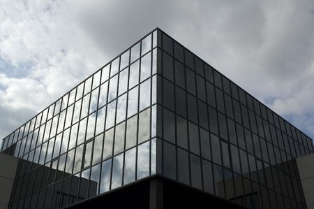 Office building with a dramatic stormy sky Stock Photo