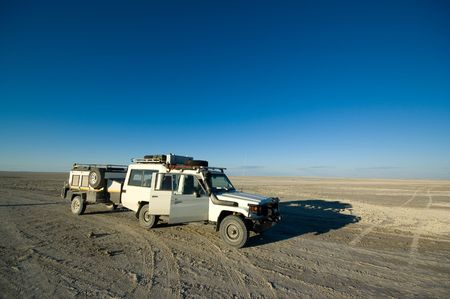 4x4 safari jeep traveling through Africa Stock Photo