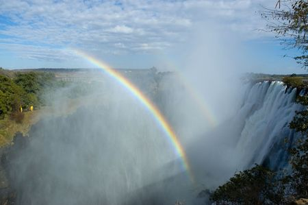 Rainbow through the fog at Victoria Falls, Zambia Stock Photo