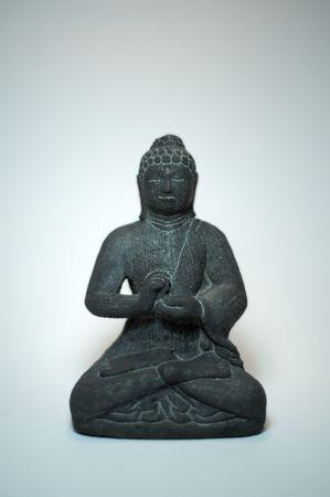 eligion: Statue of sitting buddha with white background