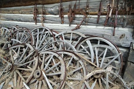 Stack of wheels used for wagons photo