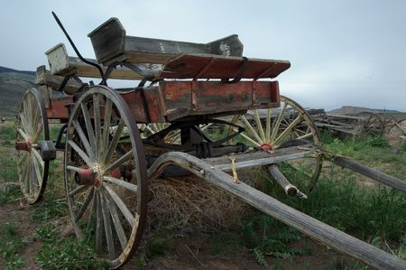 Wild west wagon on a deserted field photo