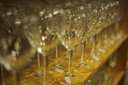 shelve: Row full of wine glasses on a shelve