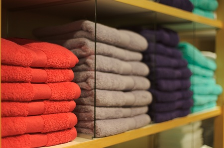 colorful bathing towels stapled on a shelf Stock Photo
