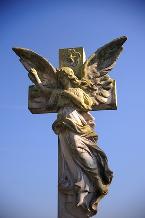 angel cemetery: Gothic style statue of an angel on a cemetery