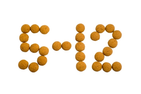 5 December spelled in pepernoten candy. Sinterklaas is a dutch holiday celebrated on December 5th with this traditional candy. Stock Photo - 15734512