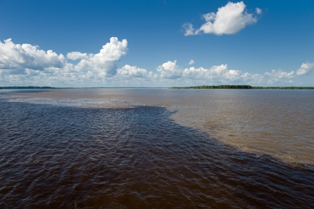 Meeting of Rio Negro River and Amazon River Stock Photo