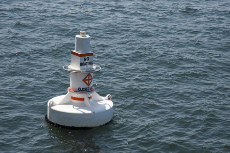 drifting: A floating white buoy drifting in the sea