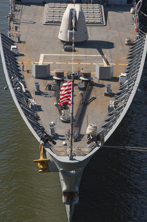 warship: The bow of a grey US warship sailing in the sea