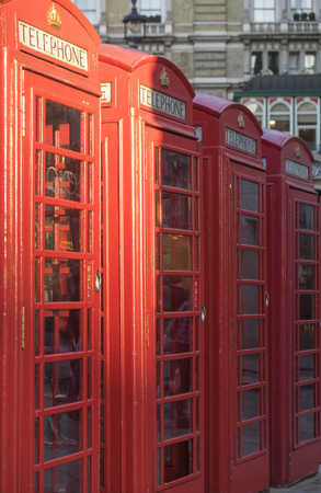 phonebooth: Four red phone booths in a row in London, UK