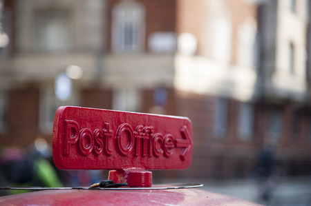 post office: Old red cast iron sign to the Post Office in London, UK