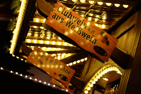 Glühwein sign at German Christmas market during the night