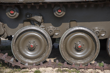 Closeup of the brown tracks of an army tank Stock Photo