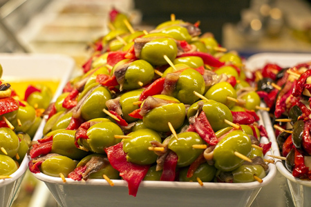 Spanish tapas with olives, peppers and ansjovis