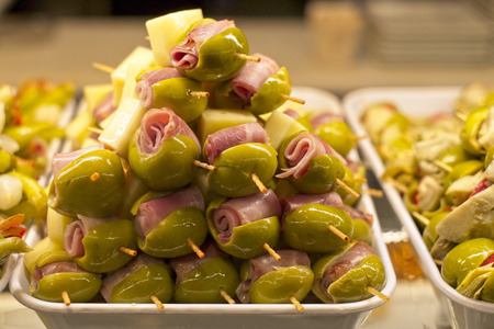 Tapas with olives, ham and cheese Stock Photo
