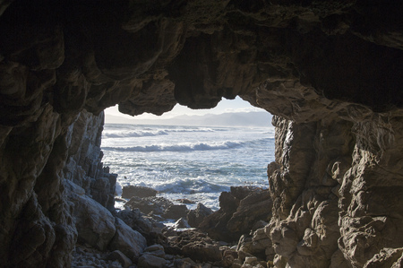 Rocky cave viewing over the sea in South Africa Stock Photo