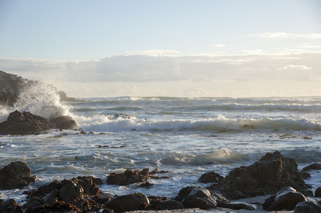 Waves of the sea near a rocky beach in South Africa Stock Photo